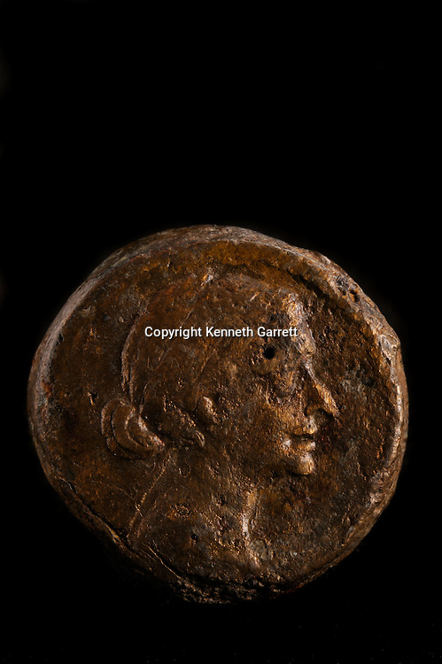 MM7836, Cleopatra; The Search for the Last Queen of Egypt; Exhibit Catalog; page 1; Cleopatra Exhibit; Egypt; Taposiris Magna; Bronze Coin; Cleopatra Face