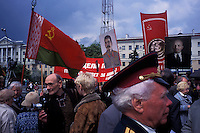 MINSK, BELARUS - MAY 9: Portraits of Joseph Stalin, center, and Vladimir Lenin, right, are carried amidst the celebrations of Victory Day on May 9, 2004 in Minsk, Belarus. For years, Belarus was frozen in its communist past. Now the radical change that has swept the former Soviet Union -- from Georgia's 2003 popular uprising to Ukraine's orange revolution last winter to the recent meltdown in Kyrgyzstan -- is catching up with President Alexander Lukashenko, a dictator whose regime has been described as Stalinism minus the Gulag. The images here capture a country and a people inexorably moving toward revolution: Student activists organizing illegally, democratic reformers meeting in rusting warehouses, protesters holding pictures of 'enemies of the state' murdered by the security services. Just beneath the apparent ordinariness and staidness of this post-Soviet republic, which is barely distinguishable from its former Soviet self, is a deep and powerful anger and a yearning for a new politics and a new possibility. That is the crux of Belarus today -- anger and yearning held together by the glimmer of a hope that tomorrow the regime may tumble. (Photo by Landon Nordeman)