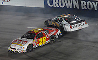 May 4, 2007; Richmond, VA, USA; Nascar Busch Series driver Clint Bowyer (2) goes high to avoid a spinning Derrike Cope (28) during the Circuit City 250 at Richmond International Raceway. Mandatory Credit: Mark J. Rebilas