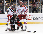 Kevin Roy (NU - 15), Sean Escobedo (BU - 21) - The Northeastern University Huskies defeated the Boston University Terriers 3-2 in the opening round of the 2013 Beanpot tournament on Monday, February 4, 2013, at TD Garden in Boston, Massachusetts.