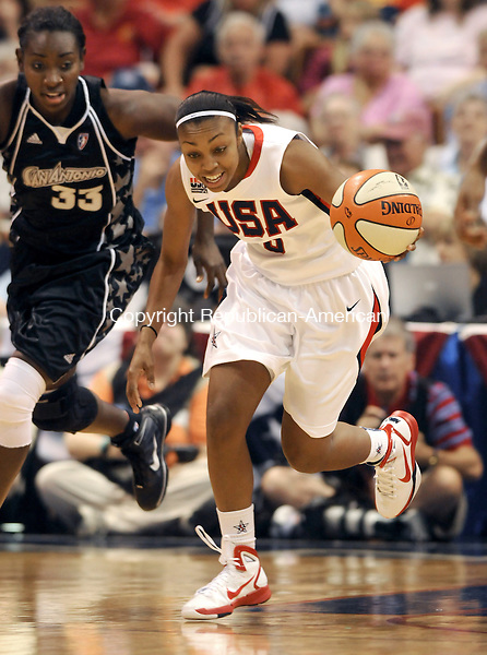 UNCASVILLE, CT 10  JULY, 2010-071010JS04-Team USA's Renee Montgomery (9) runs the ball up court in front of Sophia Young (33) of the San Antonio Silver Stars during their game Saturday at the Mohegan Sun Arena in Uncasville. <br /> Jim Shannon Republican-American