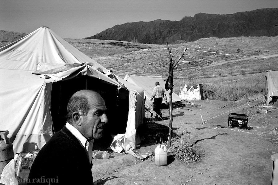 tena, northern iraq, january 2005: hermes okaha (left) and his friend emile aoyia are chrsitian settlers who have returned to resettle and rebuild a village that had been destroyed here at in the 1950s.  the assyrian christians are determined to ensure their place in iraq and reclaim their right to be here<br />