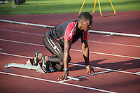 Tuesday 15th July 2014<br /> Pictured: Christian Malcolm <br /> RE: Welsh Sprinter Christian Malcolm positioned in the starting blocks, head up and looking foreword while holding a relay baton, as he warms up for the Welsh Athletics International 4x100m relay at the Cardiff International Sports Stadium, Wales, UK. His last race on home soil.