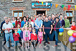 NEW POST: Dara Ó Sé cuts the tape for Padráig Murphy (centre) the new tenant propriator at the official opening of Murphys bar, The pier, Brandon, as his uncle Paddy retired.