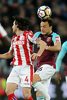 Joe Allen of Stoke City and Mark Noble of West Ham United during West Ham United vs Stoke City, Premier League Football at The London Stadium on 16th April 2018