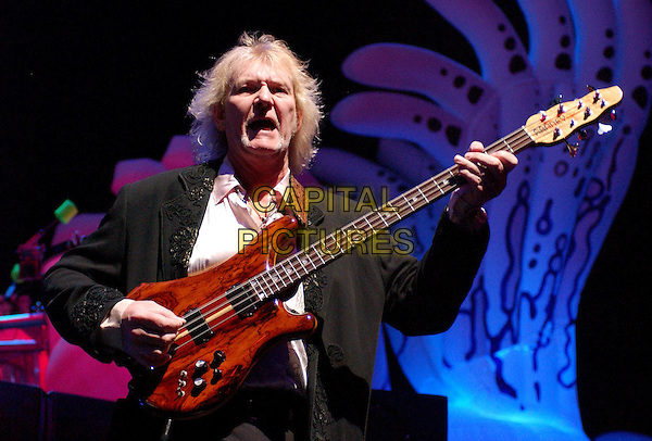 CHRIS SQUIRE-YES.performing live on their world tour at The Pond, Anaheim, California..April 20th 2004.playing guitar half length half-length on stage band gig concert on stage music.*UK sales only*.www.capitalpictures.com.sales@capitalpictures.com.©Capital Pictures