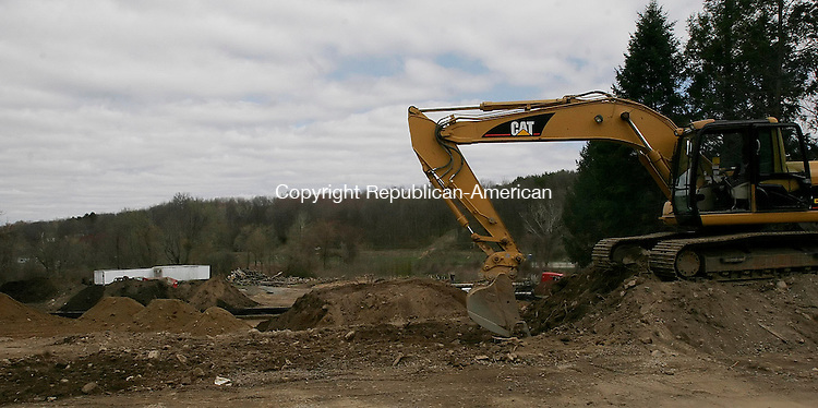 WATERTOWN, CT-17 April 2006-041706TK04- (left to right:) Environmental Services has begun excavation work on Main Street. The site will house the Advance Auto Parts store once the land has been cleared. Tom Kabelka Republican-American