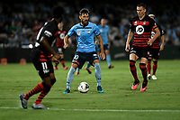 28th February 2020; Netstrata Jubilee Stadium, Sydney, New South Wales, Australia; A League Football, Sydney FC versus Western Sydney Wanderers; Milos Ninkovic of Sydney looks for a way between Mitchell Duke and Bruce Kamau of Western Sydney Wanderers