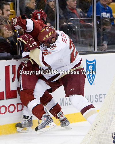 Nick Petrecki (BC 26) pins Jimmy Fraser (Harvard 9) to the boards behind the BC net. The Boston College Eagles defeated the Harvard University Crimson 6-5 in overtime on Monday, February 11, 2008, to win the 2008 Beanpot at the TD Banknorth Garden in Boston, Massachusetts.