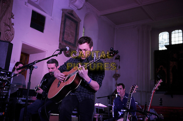 Phillip Phillips Winner of the eleventh season of American Idol, performing his first UK show, St Pancras Old Church, London, England. .11th March 2013.on stage in concert live gig performance performing music half length black blue check shirt guitar   .CAP/MAR.© Martin Harris/Capital Pictures.