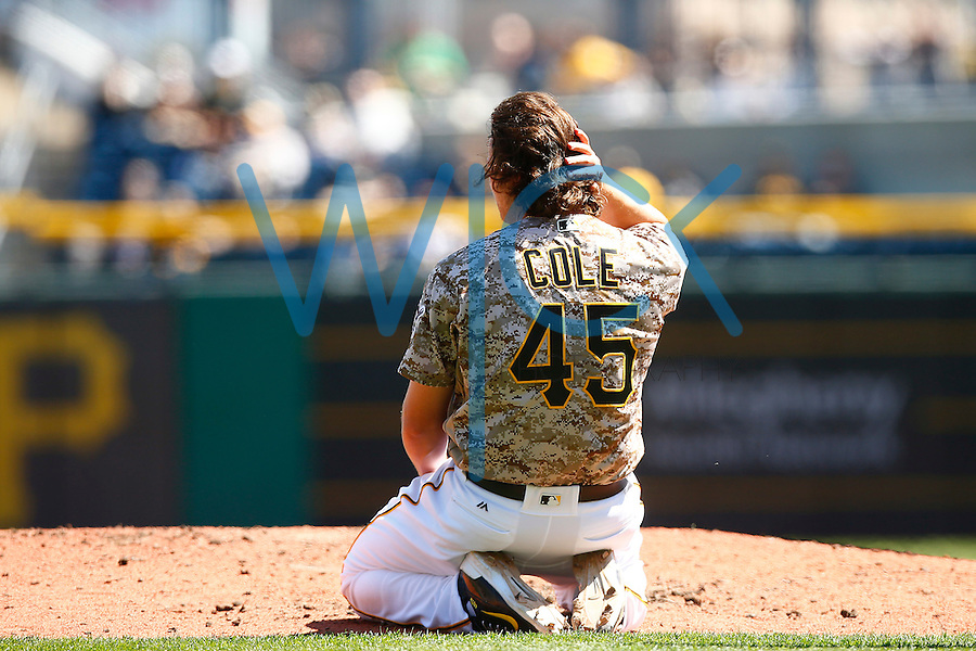 Gerrit Cole #45 of the Pittsburgh Pirates reacts on the mound after taking a hit from a come backer against the Detroit Tigers during the game at PNC Park in Pittsburgh, Pennsylvania on April 14, 2016. (Photo by Jared Wickerham / DKPS)