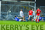 Kerins O'Rahillys Karl Mullins (#6) pounces on a loose ball to raise the green flag that deceives East Kerry keeper James Devane in the County Football Championship 3rd round game on Saturday.
