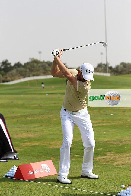 Gregory Bourdy (FRA) on the range during the Abu Dhabi HSBC Golf Championship 2013.Picture: Fran Caffrey / www.golffile.ie ..