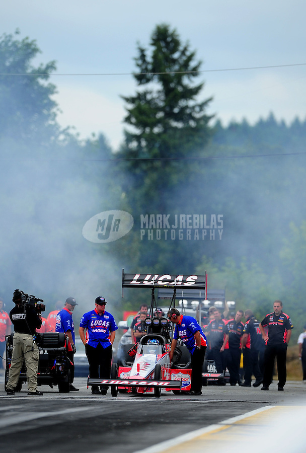 Aug. 5, 2011; Kent, WA, USA; NHRA top fuel dragster driver Shawn Langdon during qualifying for the Northwest Nationals at Pacific Raceways. Mandatory Credit: Mark J. Rebilas-