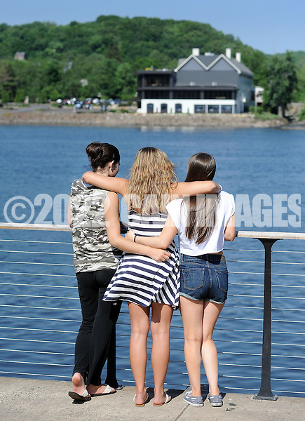 NEW HOPE, PA - JUNE 02:  From left, Lauren Fitzpatrick, 18, Allie Becker, 19, and Capri Wagner, 18 all of Newtown, Pennsylvania look out onto the Delaware River on a warm afternoon June 2, 2014 in New Hope, Pennsylvania.  The temperature reached 82 degrees in New Hope and is expected to remain in the mid-80's for the next few days. (Photo by William Thomas Cain/Cain Images)