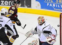 Chicago Wolves' Bill Sweatt (23) scores on San Antonio Rampage goaltender Jacob Markstrom (30) during the first period of an AHL hockey game, Thursday, April 19, 2012, in San Antonio. (Darren Abate/pressphotointl.com)