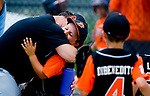 WATERBURY, CT-0712117JS14--Water-Oak's Quinn Delaney (7) gets a congratulatory hug from one of the coaches after they defeated the Bonnie's of Brooklyn during their consolation bracket game in the Roberto Clemente Tournament Thursday at the Waterbury PAL field. <br /> Jim Shannon Republican-American