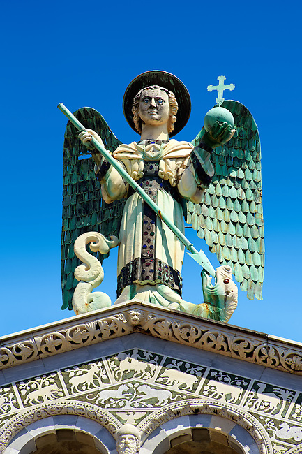 Close up of the statue of St Michele of the 13th century Romanesque facade of the San Michele in Foro,  a Roman Catholic basilica church in Lucca, Tunscany, Italy