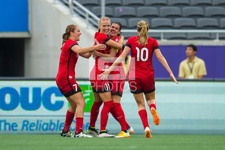 Orlando, FL - Sunday June 26, 2016: Dagny Brynjarsdottir, Christine Sinclair celebrates scoring  during a regular season National Women's Soccer League (NWSL) match between the Orlando Pride and the Portland Thorns FC at Camping World Stadium.