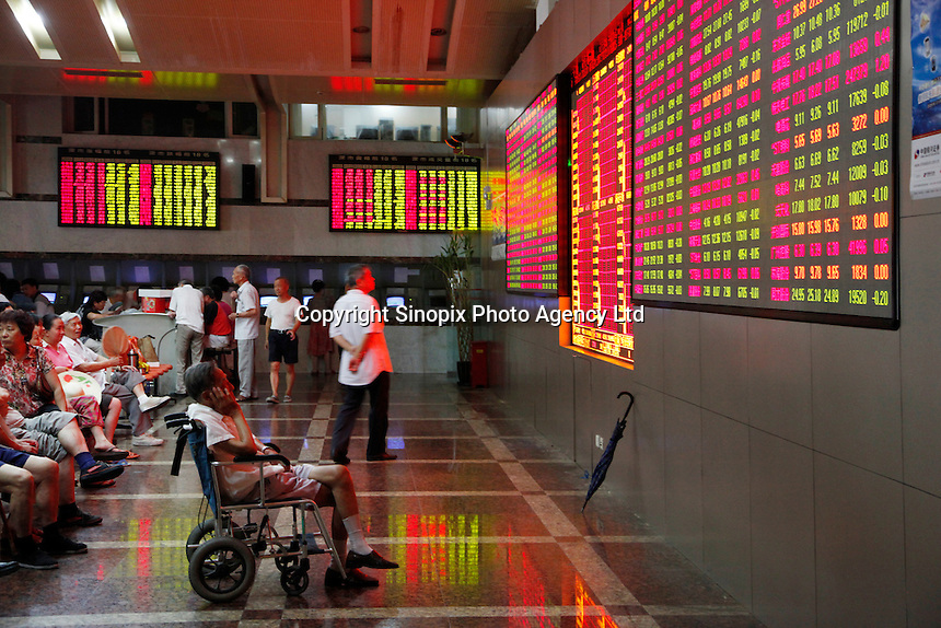 Investors monitor... trade stocks at a securities exchange house in Shanghai. The Shanghai Stock Exchange (SSE) is one of the three stock exchanges operating independently in the People's Republic of China, the other two are the Shenzhen Stock Exchange and the Hong Kong Stock Exchange. It is the world's sixth largest stock market by market capitalization at US$2.4 trillion as of Aug 2010..17 Aug 2010.