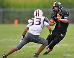 Wesclin running back Jamie Kattenbraker (right) weaves as he tries to evade Dupo's Freddie Macmahon. Wesclin defeated Dupo 34-30 on Saturday August 31, 2019 in a game that was stopped Friday night at halftime due to storms. <br /> Tim Vizer/Special to STLhighschoolsports.com