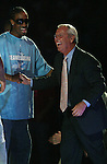 """13 October 2006: UNC's Quentin Thomas (l) and head coach Roy Williams (r). The University of North Carolina at Chapel Hill Tarheels held their first Men's and Women's basketball practices of the season as part of """"Late Night with Roy Williams"""" at the Dean E. Smith Center in Chapel Hill, North Carolina."""