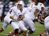 SEATTLE, WA - September 28, 2013: Stanford quarterback Evan Crower hands the ball off during play against Washington State at CenturyLink Field. Stanford won 55-17