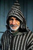 Old Muslim Man with hood and smiling in Tangier Morocco Africa Portrait