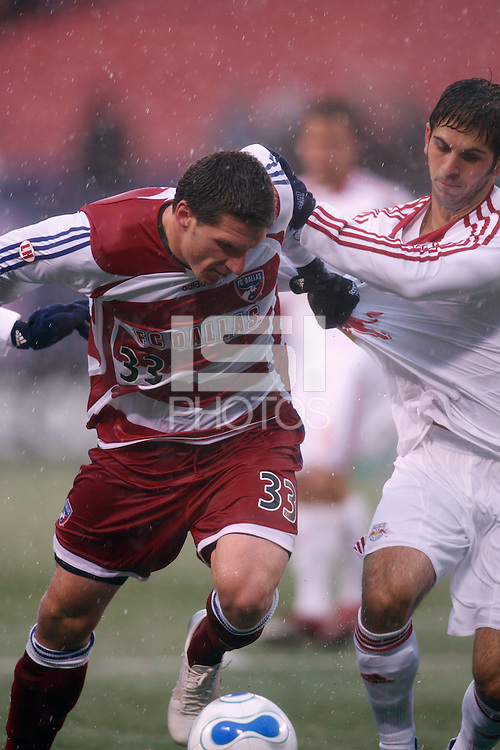 FC Dallas forward (33) Kenny Cooper is defended by Red Bulls defender (4) Carlos Mendes. The Red Bulls defeated FC Dallas 3-0 at Giants Stadium, East Rutherford, NJ, on April 15, 2007.