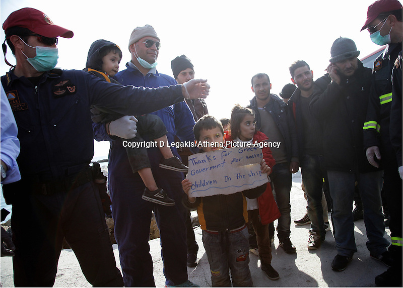 Pictured: Two young children holding a makeshift sign thanking Greece for accepting them Thursday 27 November 2014<br /> Re: One of the largest refugee boats in recent months has disembarked refugees in Ierapetra, Crete. The freighter Baris, carrying 700 people thought to be from Syria and Afghanistan, is being towed by a Greek frigate.<br /> Officials and Red Cross volunteers prepared an indoor basketball stadium as interim shelter in the southern Cretan port town of Ierapetra on Wednesday ahead of the migrants' expected arrival.<br /> Greek officials said the Baris, which lost propulsion on Tuesday, was being towed slowly in poor sea conditions and would arrive after nightfall, probably early Thursday.<br /> They said it was unclear which Mediterranean location had been the departure point for the 77-meter (254-foot) vessel, which was sailing under the flag of the Pacific nation of Kiribati.