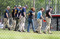 Evidence technicians from the FBI comb through the crime scene for evidence after a gunman opened fire on members of Congress who were practicing for the annual Congressional baseball game in Alexandria, Virginia on Wednesday, June 14, 2017. Photo Credit: Ron Sachs/CNP/AdMedia