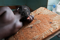 A woman in labor rests on the bed in the delivery room of the labor ward of Arua Hospital, Uganda.