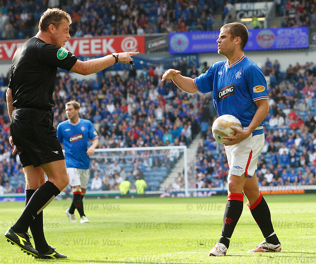 Jerome Rothen feels the wrath of referee Iain Brines as he tries to take a quick free kick in the last minute of the match