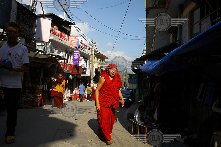 A monk on a street in the town of Mcleod Ganj, home to a large community of exiled Tibetans.