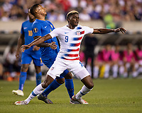 PHILADELPHIA, PA - JUNE 30: Gyasi Zardes #9 and Darryl Lachman #4 contest the ball during a game between Curaçao and USMNT at Lincoln Financial Field on June 30, 2019 in Philadelphia, Pennsylvania.