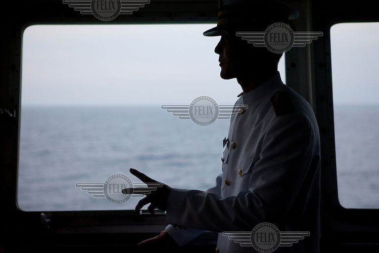 Captain Jin-Won Kim on the captain's bridge on the Eastern Dream ferry in the harbour in Donghae.