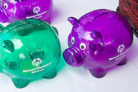 Green and purple piggy banks for sale at boutique. Special Olympics U of M Bierman Athletic Complex. Minneapolis Minnesota USA