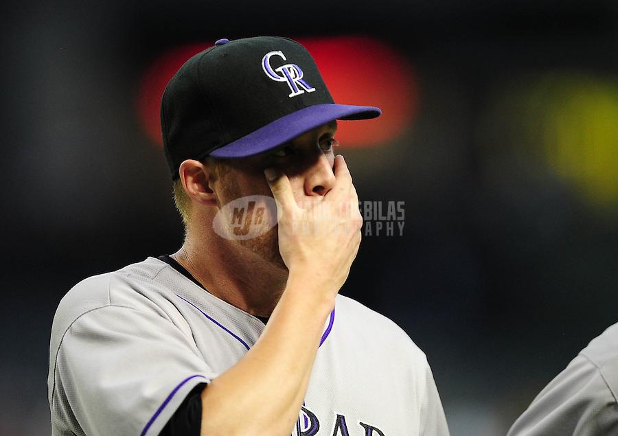 Jun. 6, 2012; Phoenix, AZ, USA; Colorado Rockies pitcher Josh Outman reacts in the third inning against the Arizona Diamondbacks at Chase Field.  Mandatory Credit: Mark J. Rebilas-