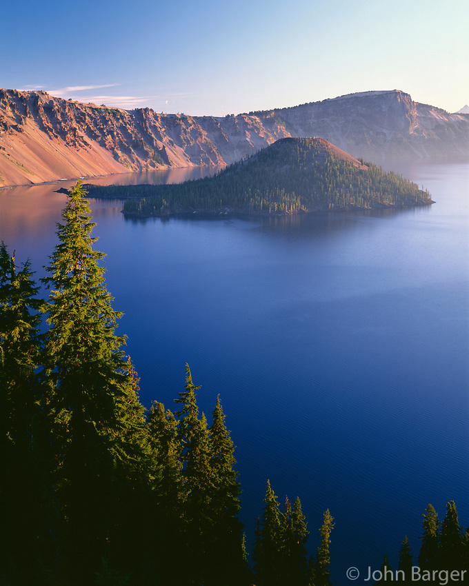 ORCL_074 - USA, Oregon, Crater Lake National Park, Sunrise on west rim of Crater Lake with Wizard Island and distant Llao Rock.