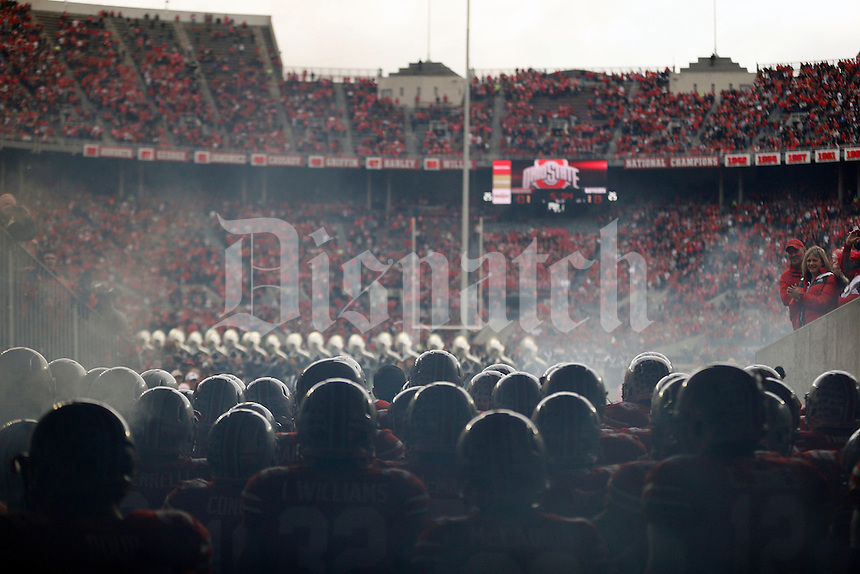 Ohio State Buckeyes football team waits to take the field before their game against Rutgers Scarlet Knights at Ohio Stadium on October 18, 2014.   (Dispatch photo by Kyle Robertson)
