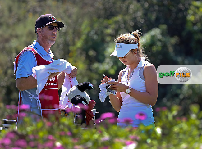 29 MAR15 Veteran Caddie Mike Bestor with Alison Lee during Sunday's Final Round of The KIA Classic at Aviara Golf Club in LaCosta, California. (photo credit : kenneth e. dennis/kendennisphoto.com)