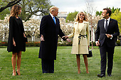U.S. President Donald Trump with France's president Emmanuel Macron and First Ladies Melania Trump and Brigitte Macron arrive to plant a tree, a gift from the President and Mrs. Macron, on the South Lawn of the White House in Washington, D.C., U.S., on Monday, April 23, 2018. As Macron arrives for the first state visit of Trump's presidency, the U.S. leader is threatening to upend the global trading system with tariffs on China, maybe Europe too. <br /> Credit: Yuri Gripas / Pool via CNP