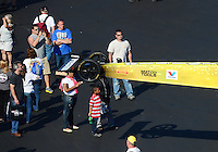 Apr. 14, 2012; Concord, NC, USA: NHRA fans look at the car of top fuel dragster driver Spencer Massey as the car is put back in the trailer after qualifying Saturday for the Four Wide Nationals at zMax Dragway. Mandatory Credit: Mark J. Rebilas-
