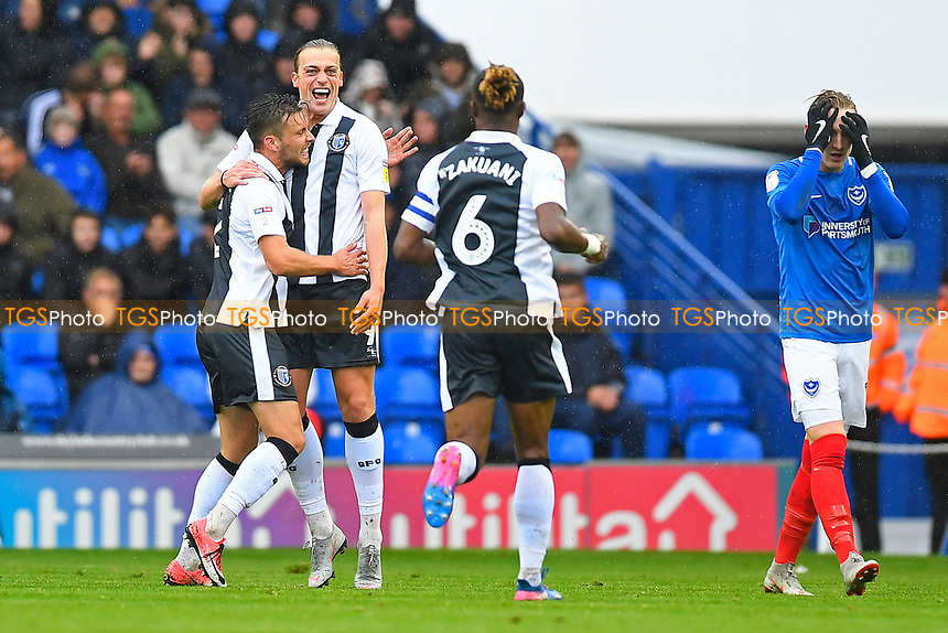 Tom Eaves of Gillingham left celebrates after scoring the first goal as Ronan Curtis of Portsmouth right covers his eyes during Portsmouth vs Gillingham, Sky Bet EFL League 1 Football at Fratton Park on 6th October 2018
