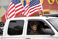 NWA Democrat-Gazette/FLIP PUTTHOFF<br /> PARADE READY<br /> Eugene Keister of Fayetteville, a World War II veteran, rides Satuday Nov. 11 2017 to the Lowell Veterans Day parade. Keister served in a tank unit during the war and wore his World War II uniform in the parade.  The group Remember Everyone Deployed, or Red Friday, organized the parade that traveled south on  Dixieland Road. Red Friday provides support for veterans from the time start basic training into retirement, said Mike Whitehead with Red Friday. Rogers High School Marching Band, military, police and firefighting vehicles and veterans were part of the Saturday morning parade.