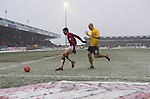Northampton Town 1 Oxford United 0, 23/03/2013. Sixfields, League Two. Oxford United are the visitors to Sixfields as the long British winter continues in Northamptonshire. Fierce competition as Oxford's Andy Whing tries to get possession of the ball. Photo by Simon Gill