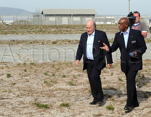 FIFA President Joseph Blatter (L) and FIFA Executive Committee member Tokyo Sexwale (R) during a meeting of FIFA Executive Committee on Robben Island off Cape Town, South Africa, 03 December 2009. Photo: Bernd Weissbrod/Actionplus - UK Editorial Use