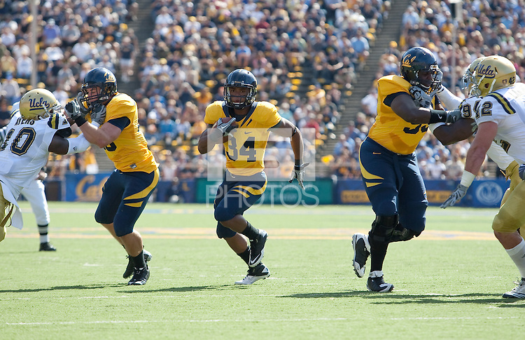 Shane Vereen runs through the hole. The California Golden Bears defeated the UCLA Bruins 35-7 at Memorial Stadium in Berkeley, California on October 9th, 2010.