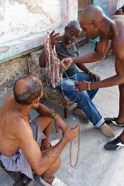 Havana, Cuba. Central Habana. Arm band seller.