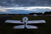 Reflective silver aircraft at dusk, Arlington Fly-In 2016, WA, USA.